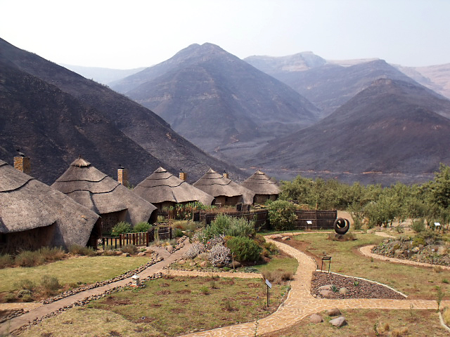 Burnt mountain landscape with Maliba Lodge in foreground