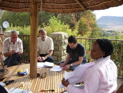 Mamokola teaches a group outside