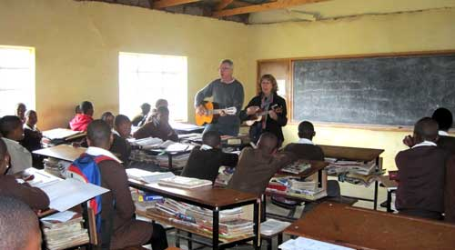 Gavan and Judy Hogan singing to students