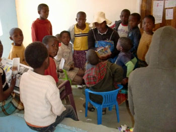 Lesotho children being read to on Christmas day