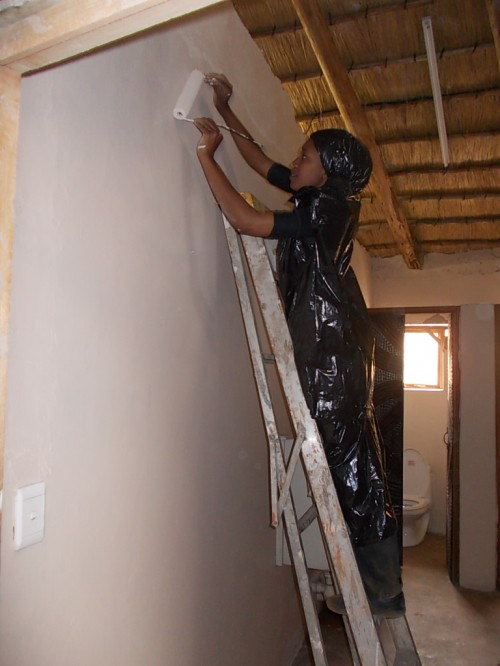 maliba staff painting after fire